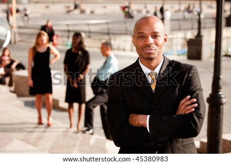 A portrait of a content African American Business Man - stock photo