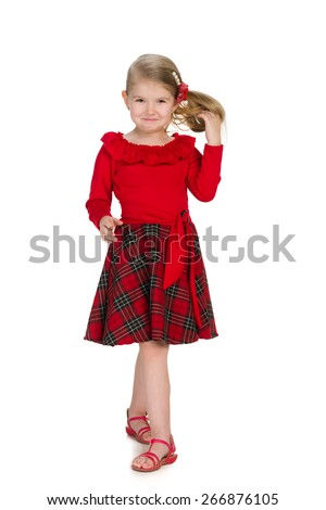 A portrait of a cool little girl in the red dress on the white background