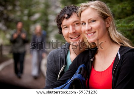 A portrait of a couple of happy campers - stock photo