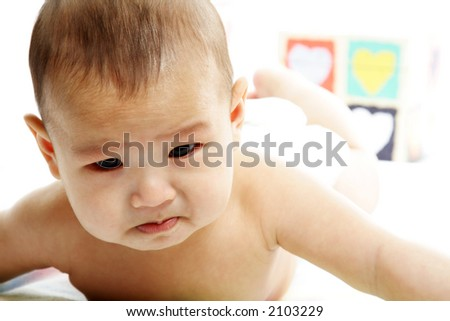 A portrait of a crying cute baby boy - stock photo