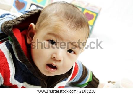 A portrait of a cute baby boy - stock photo