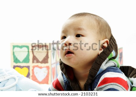 A portrait of a cute baby boy - stock photo