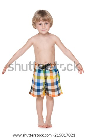 A portrait of a cute little boy getting ready for swimming - stock photo