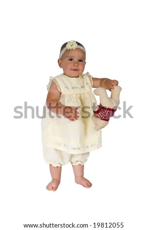 A portrait of a cute one year old girl isolated on a white background.