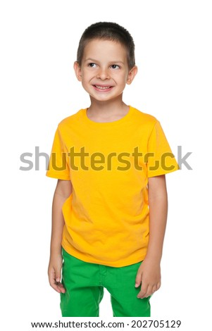 A portrait of a cute young boy in the yellow shirt on the white background