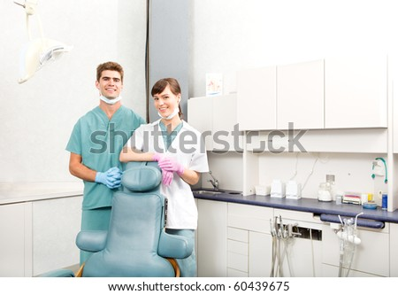 A portrait of a dental team in a clinic smiling at the camera - stock photo