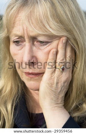 A portrait of a depressed woman in her sixties.