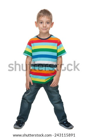 A portrait of a fashion cute little boy in a striped shirt against the white background - stock photo