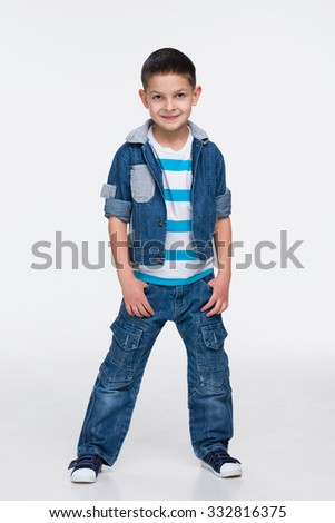 A portrait of a fashion little boy in a jeans suit - stock photo