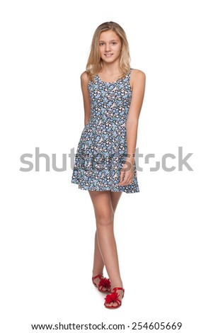 A portrait of a fashion teen girl on the white background - stock photo