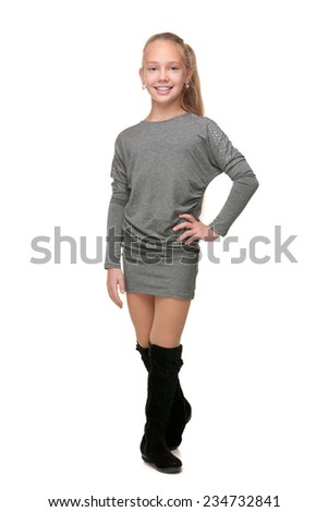 A portrait of a fashion young girl on the white background - stock photo