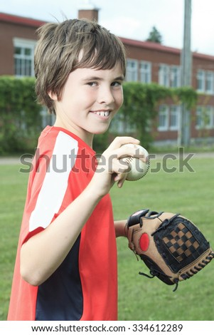 A Portrait of a father and son play baseball in a field - stock photo