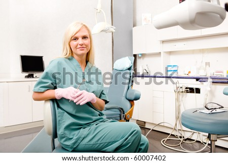 A portrait of a female dentist in a clinic - stock photo