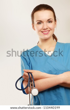 A portrait of a female doctor holding a stethoscope