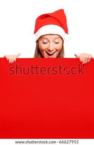 A portrait of a female Santa holding a red board, a lot of space for text - stock photo