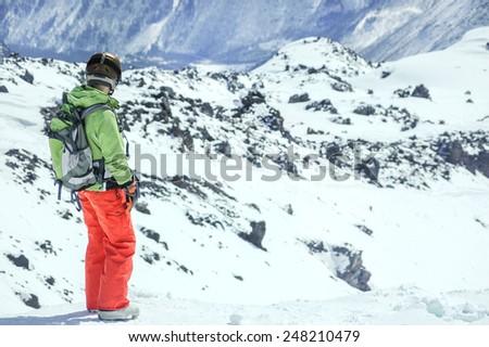 a portrait of a female snowboarder wearing a helmet - stock photo