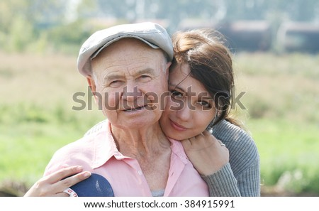 A portrait of a granddaughter with her grandfather - stock photo