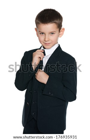 A portrait of a handsome boy in black suit on the white background - stock photo