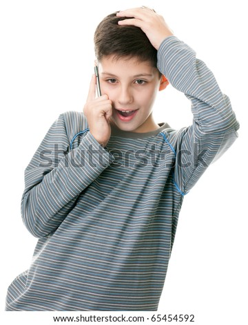 A portrait of a handsome boy talking on the mobile phone; isolated on the white background - stock photo