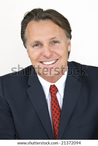 a portrait of a handsome forties businessman looking toward the camera - stock photo