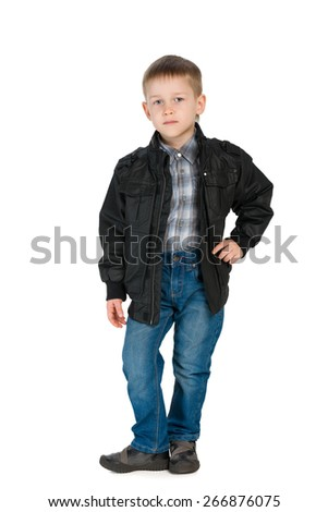 A portrait of a handsome little boy in a jacket against the white background