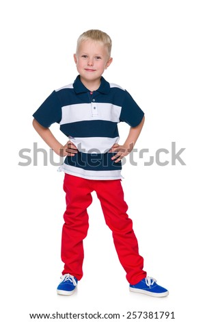 A portrait of a handsome little boy in the red pants on the white background - stock photo