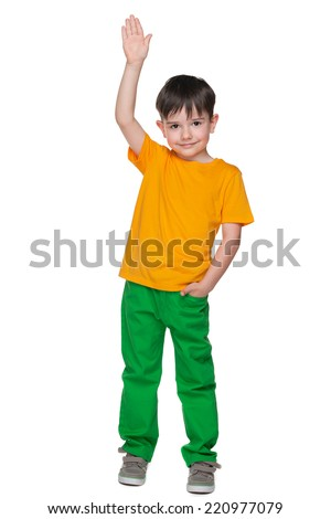 A portrait of a handsome little boy in the yellow shirt on the white background - stock photo