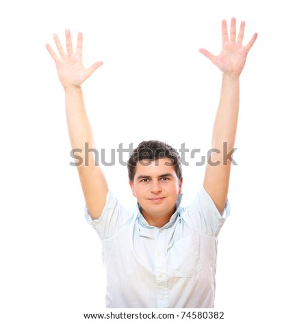 A portrait of a handsome man with his hands up smiling over white background