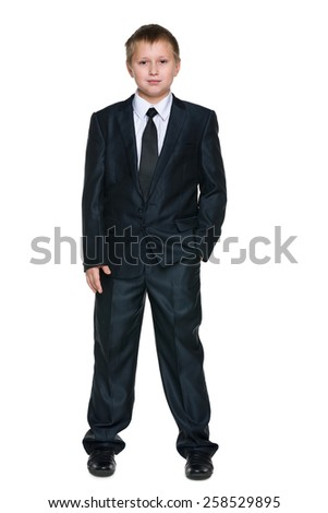 A portrait of a handsome schoolboy in the suit against the white background - stock photo