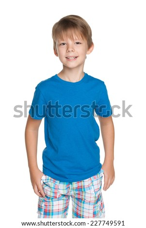 A portrait of a handsome young boy in a blue shirt on the white background