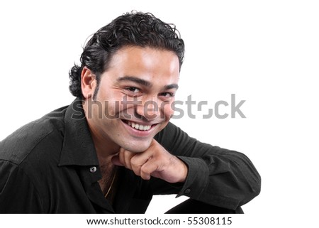 A portrait of a happily smiling Indian guy, isolated on white studio background. - stock photo