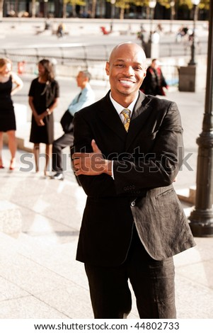 A portrait of a happy African American Business Man outdoors - stock photo