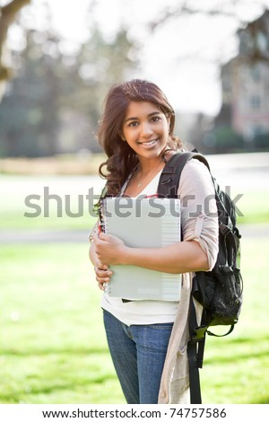 A portrait of a happy asian student on campus - stock photo
