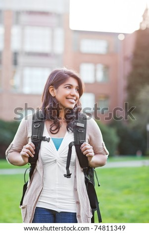 A portrait of a happy asian student on campus