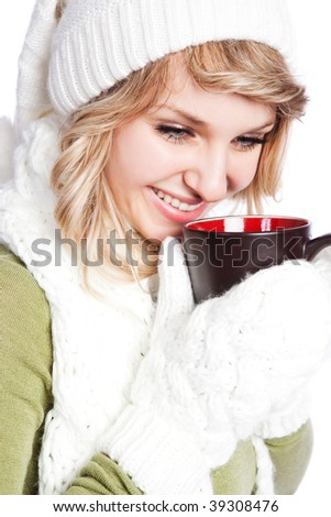 A portrait of a happy beautiful caucasian winter woman holding a coffee cup - stock photo