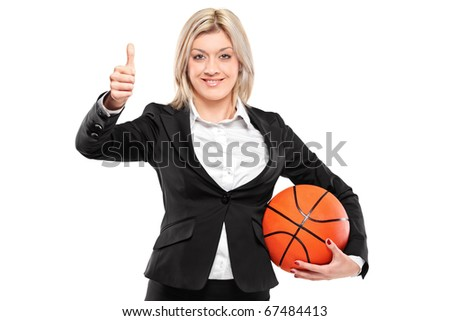 A portrait of a happy businesswoman holding a basketball and giving thumbs up isolated on white background - stock photo