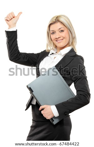 A portrait of a happy businesswoman holding a laptop and giving thumbs up isolated on white background - stock photo
