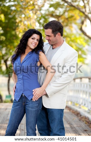 A portrait of a happy couple in the park - stock photo