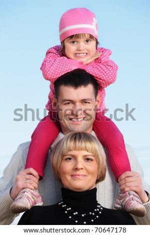A portrait of a happy family spending time together in the park - stock photo