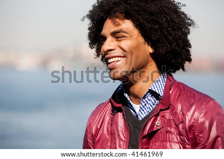 A portrait of a happy laughing African American man - stock photo