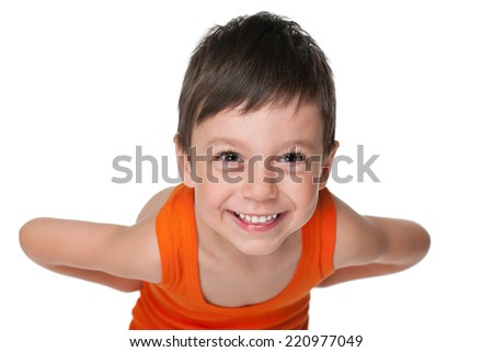 A portrait of a happy little boy against the white background - stock photo