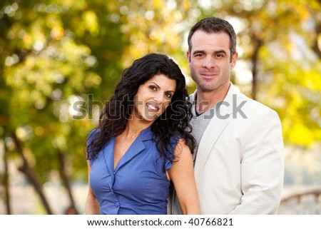 A portrait of a happy male and female in a park