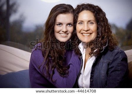 A portrait of a happy mother and daughter