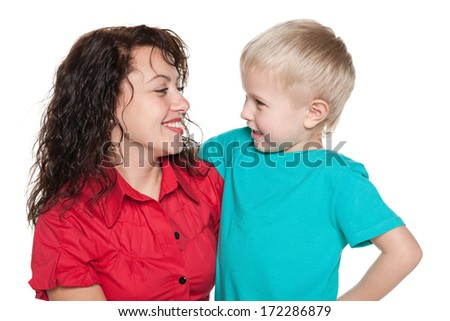 A portrait of a happy mother with her son - stock photo