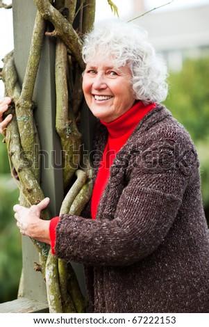 A portrait of a happy senior woman - stock photo