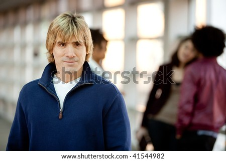 A portrait of a happy with with friends in the background - stock photo