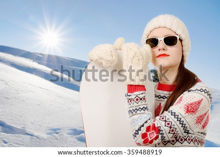a portrait of a happy young girl snowboarding with sunglasses - stock photo