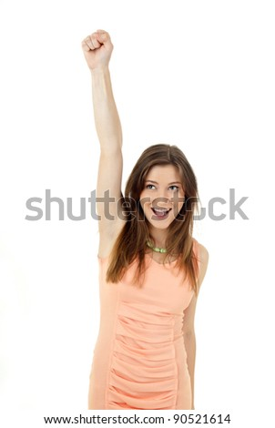 A portrait of a happy young woman with her hands up over white background - stock photo