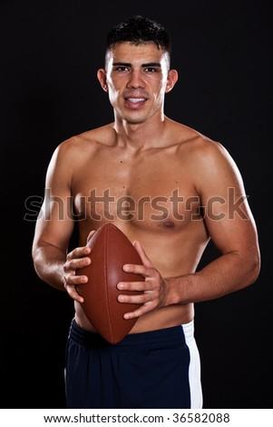 A portrait of a hispanic american football player - stock photo
