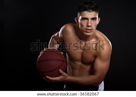 A portrait of a hispanic basketball player - stock photo
